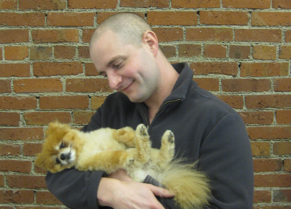 Aaron and his Pomeranian, Caramel
